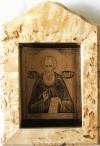 Изображение Александра Свирского в рамке из карельской березы